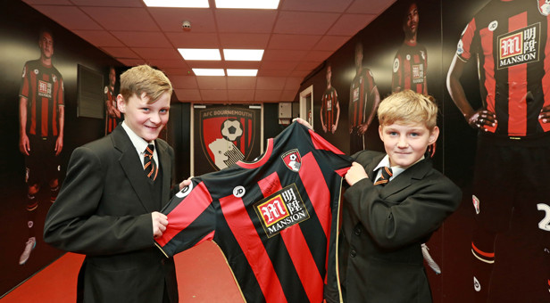 GETTING SHIRTY: St Aldhelm's was also presented with its own Cherries shirt which will be signed by the team and displayed at the Club