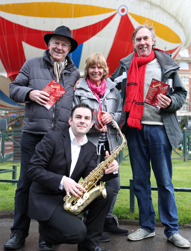 Festival director, Gerry Clarke with festival PA, Sandra Bird and saxophonist Tom Gwyther meet local film producer John Cadd during a break in filming in the town centre recently