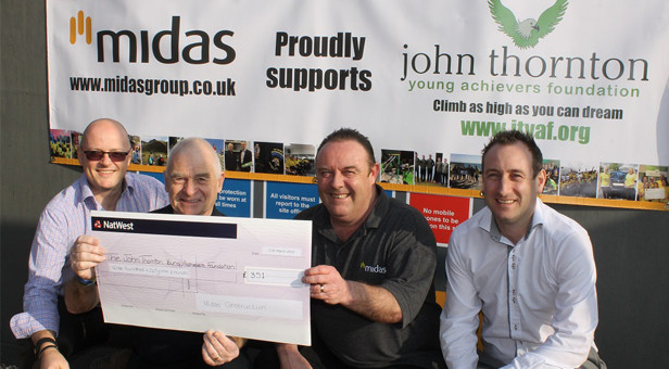 Peter Thornton (second from left) receives a cheque from Midas Construction