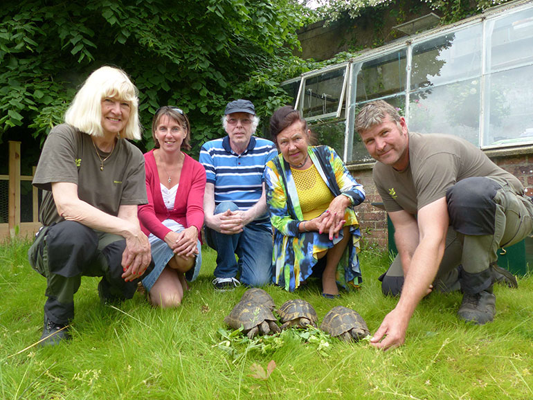 Staff at Kingston Lacy with tortoises ©National Trust / Katharine Bundy