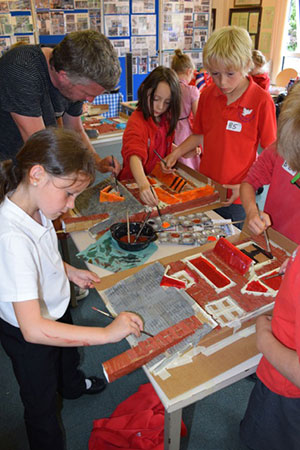 Artist Darrell Wakelam shows St John's First School pupils how to decorate the 3D Models