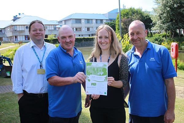 (From L-R) Trust Estates Manager Martin Lovell celebrates with colleagues Head Garderner David McInerney, Sustainability Manager Laura Dale and colleague in Estates Paul Fox