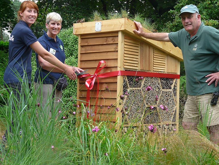 L to R: Megan Lowe and Nicky Hoare with Neil Lucas at the official opening of Knoll Gardens' new luxury bee hotel
