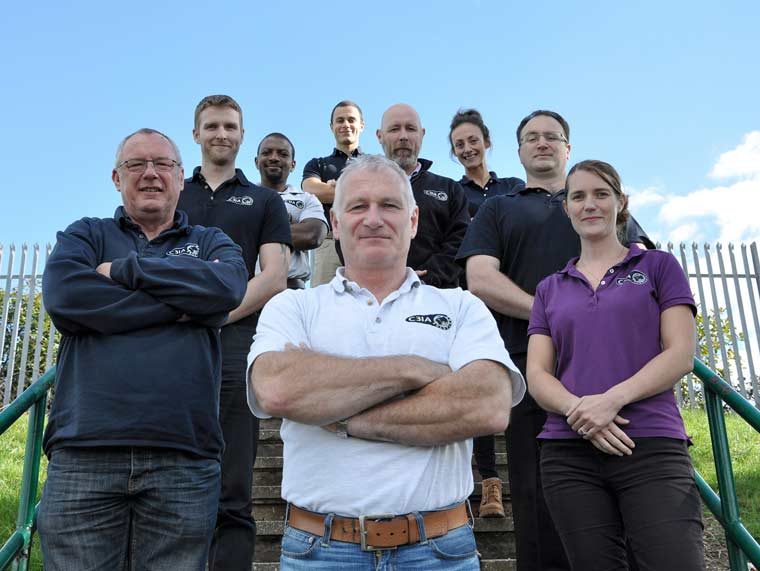 Matt Horan (front) and some staff of C3IA, a cyber security firm based in Poole