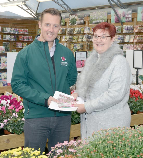 Terry Head presents Emma Masterman with her £100 worth of vouchers for Stewarts Garden Centres