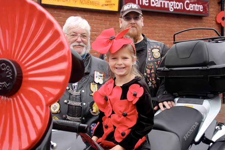 BEST DRESSED POPPY: Tilly Green (6) with two Royal British Legion Riders, 'Lump' from Bournemouth and veteran Ivor from St Leonards, who is the new county rep for the riders