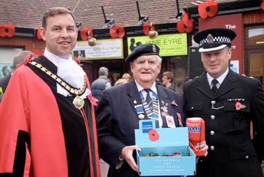 DORSET COUNTY LAUNCH OF THE NATIONAL POPPY APPEAL: L-R Mayor of Ferndown Cllr Mike Parkes, Mick Arnold MBE and Chief Superintendent Colin Searle outside the Barrington Theatre
