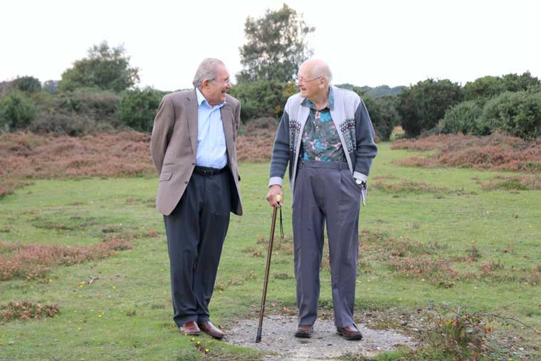 Ex-prison official Gordon Forsey and former prisoner of war Hans Strehlau reminisce at the site of the former POW camp at Setley, near Brockenhurst.