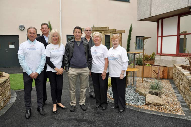 Steve Blonstein and trustees of Dorset Cancer Care Foundation, the charity he tasked with finding projects to benefit from his late aunt's will – in the new Orchard Garden at the Royal Bournemouth Hospital.