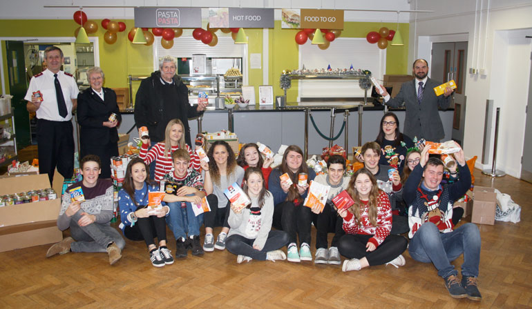 Ringwood School staf and sixth formers bring Christmas cheer to the homeless this Christmas