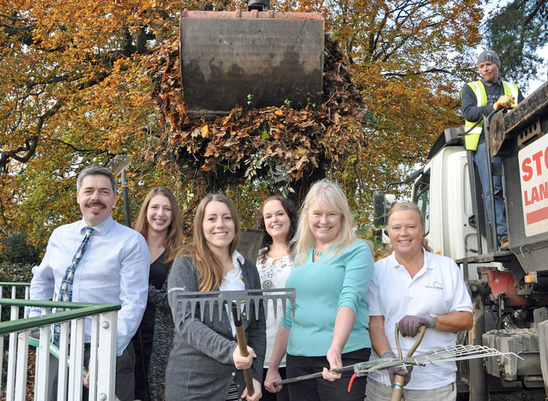 Alison Brencher of Eco Sustainable Solutions (third left) with (left to right) Brendan Howard, General Manager, The Grove; Hayley Johnston and Sarah Freeman, Ceuta Group, and Anita Rigler and Teresa Teal of Macmillan Caring Locally/The Grove with Gary Walsh, of Dorset Soil and Aggregates, at the controls of the grab.