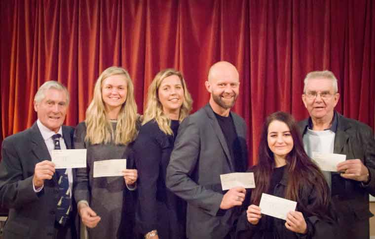 Picture shows (L-R): Dr Michael Penn (Macmillan Caring Locally); Kezia Needham (Meningitis Research Foundation); Georgina Smith (HCP Chairman); Matthew Smith (Make-A-Wish UK), Elle Paskins (Ella Turner Support Fund) and John Gayler (Macmillan Cancer Support) at the cheque presentation made during a Charity Players' Snow White and the Seven Dwarfs rehearsal.