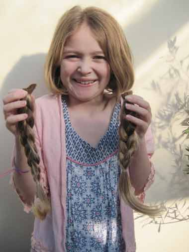 Eight-year-old Niamh Bowers from Fordingbridge has sacrificed her long, golden tresses for the Little Princess Trust.