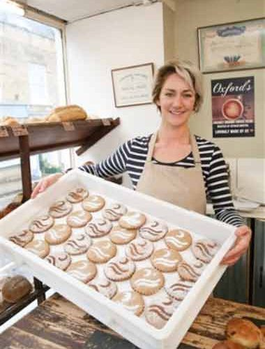 Oxfords' Sherborne Manager, Rosie Allan, displays the new Raleigh biscuits