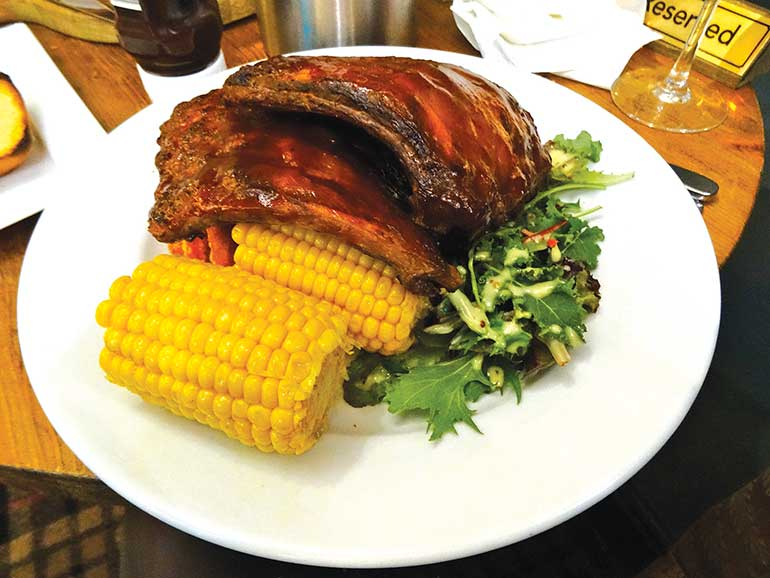 Avon Causeway: Rack of barbecue ribs with corn on the cob, sweet potato fries and dressed leaves