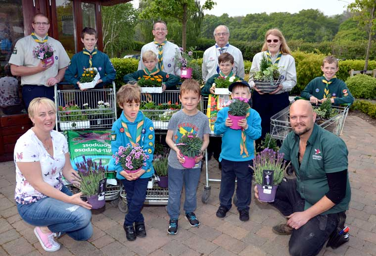 Stewarts Garden Centre donates £100 to tired Scout Hut in Ferndown