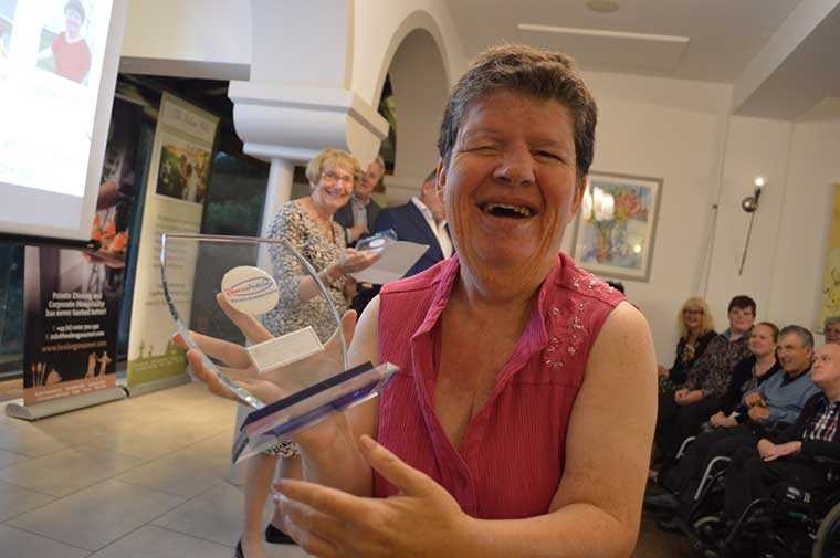 Carole winning an award in 2016