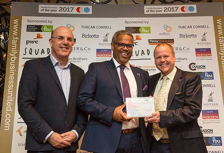 Nick Douch (centre) and Jonathan Stretch (right) receive the family business award from Paul Andrews (left) of Family Business United