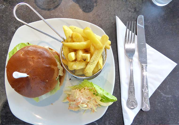 Homemade chargrilled Dudsbury burger in brioche bun with Cheddar cheese and fries