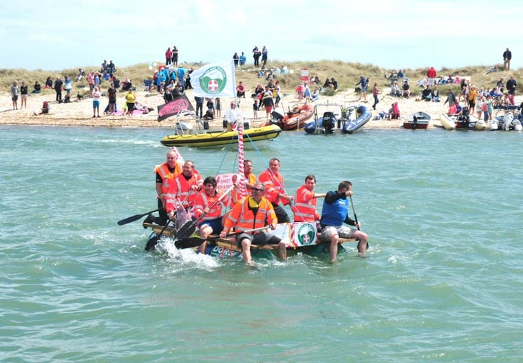 Matthew Parker, paralegal at Humphries Kirk, took part in the annual RNLI Raft Race at Mudeford Quay