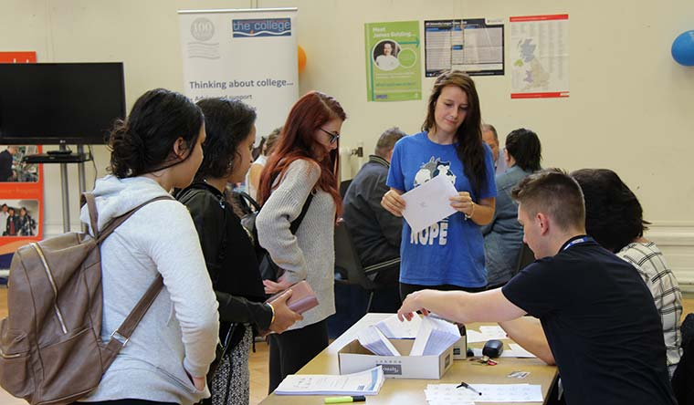 Students of Bournemouth and Poole College pick up their results