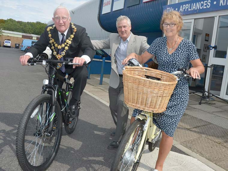 Christchurch Mayor Cllr Nick Geary and Mayoress Mrs Gillian Geary on the electric bikes with Ian Griffiths
