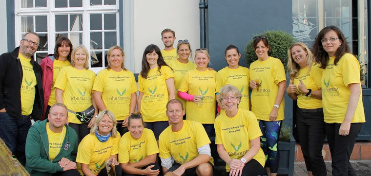A team of 22 supporters of the John Thornton Young Achievers Foundation have walked a marathon to raise important funds