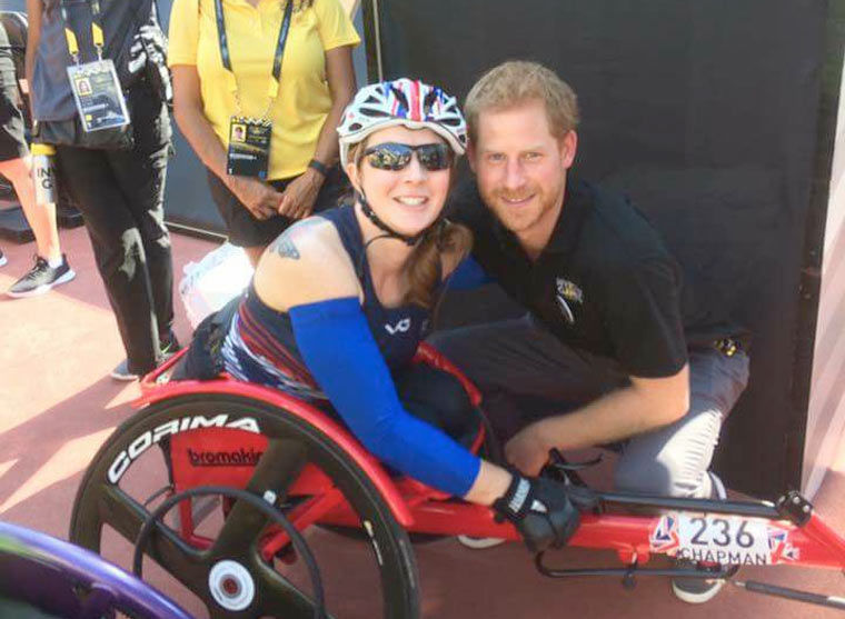 Lindsay Chapman, winner of the IT5 wheelchair 100m final at the Invictus Games with HRH Prince Harry