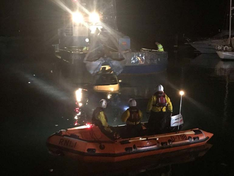 RNLI pull car out of Poole Harbour