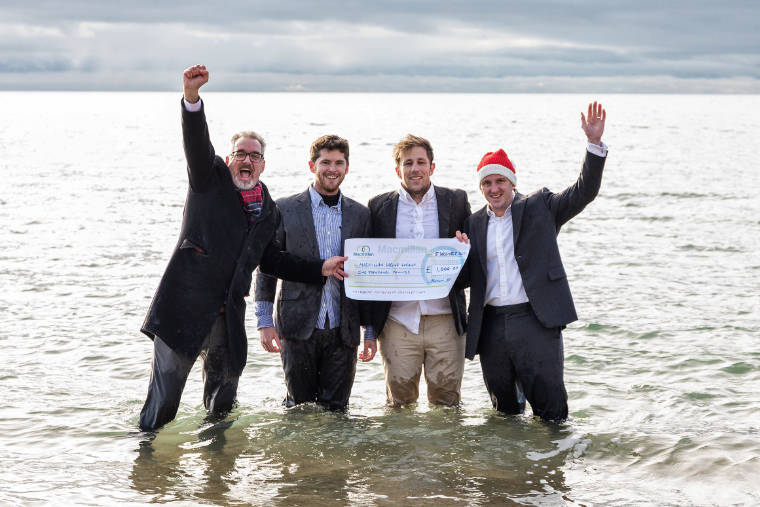 Solicitors 'Dip In' with £1K sponsorship of Macmillan's White Christmas Dip at Boscombe Pier