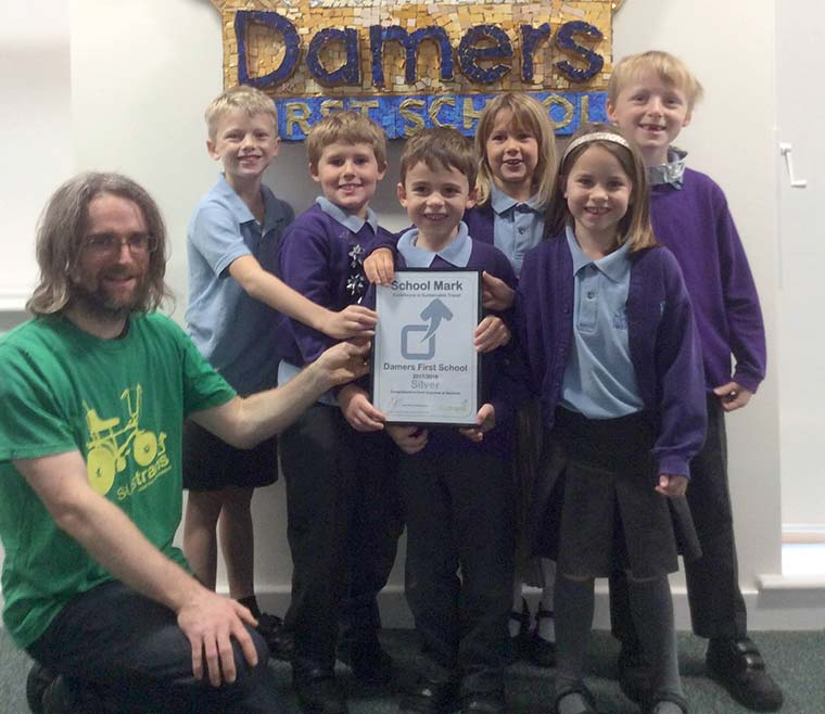 Sustrans schools officer Jonathan Dixon presented the award to the children of Damers First School