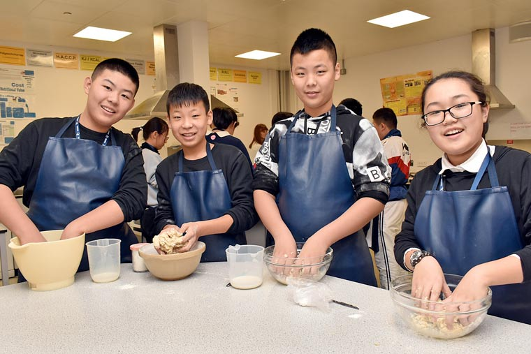 Chinese students make a cream tea the British way at Wimborne's QE