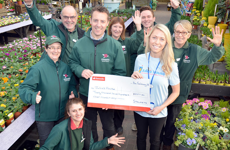 Stewarts Garden Centre Terry Head presents cheque to Laura Kelly Julia's House