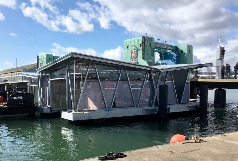 New chapter in Poole Lifeboat Station's history as floating boathouse is greeted