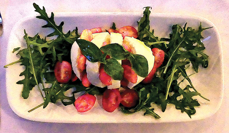 Buffalo mozzarella, cherry tomatoes and rocket