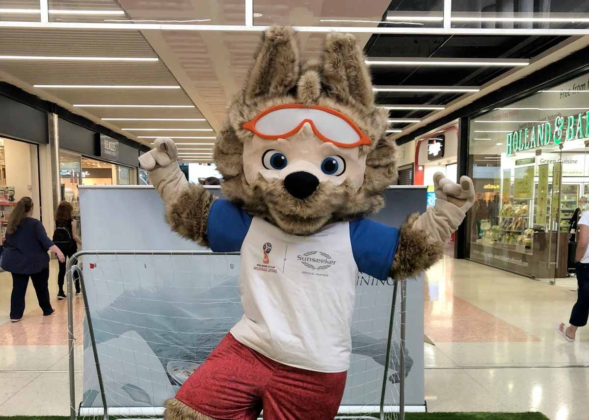 Official FIFA World Cup mascot plays football with customers at Dolphin Shopping Centre in Poole