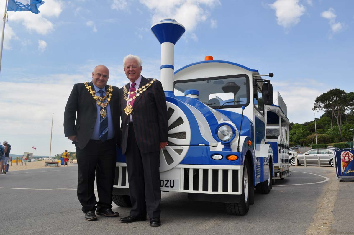 Mayor of Poole Cllr Sean Gabriel and Mayor of Bournemouth Cllr Derek Borthwick celebrating the extension of the land train into Poole.