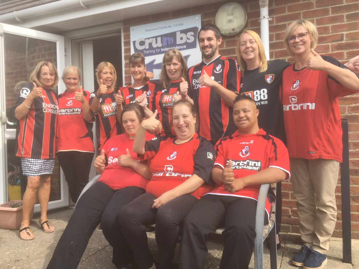 The Crumbs team celebrate as AFC Bournemouth's club charity of the year