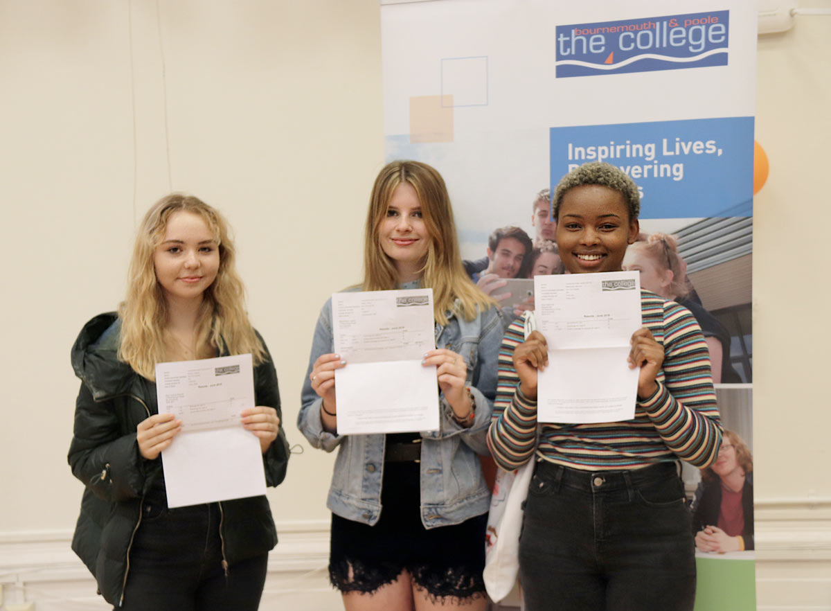 Sophie Bullock, Robyn Staton and Maurine Macdonald collect their A-level results