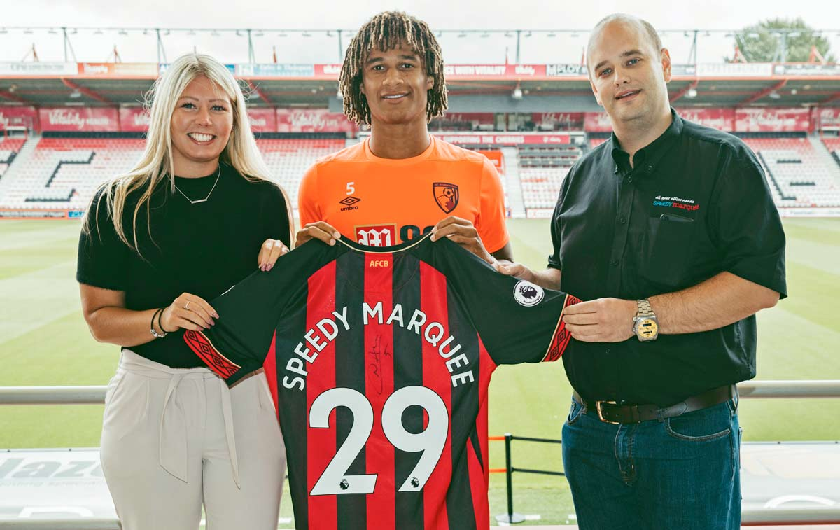 (L-R) AFC Bournemouth's partnerships manager Amy Brunton; Cherries star, Nathan Ake and Speedy Marquee's, Matthew Hickman