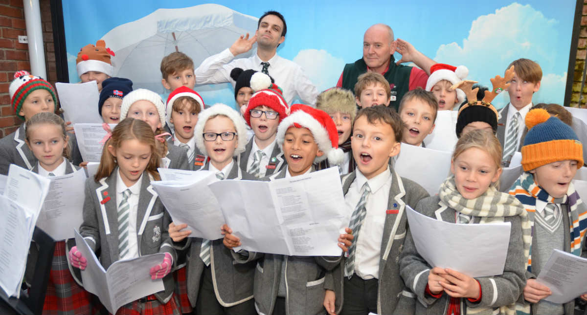 Angelic singing raises funds and Christmas boxes for charities