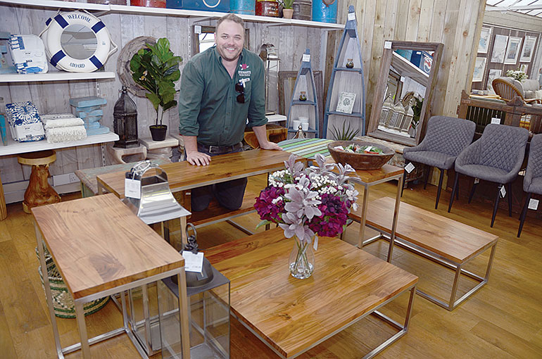 Karl Read, Outdoor Living Buyer Manager at Stewarts Garden Centre with the exclusive new table range
