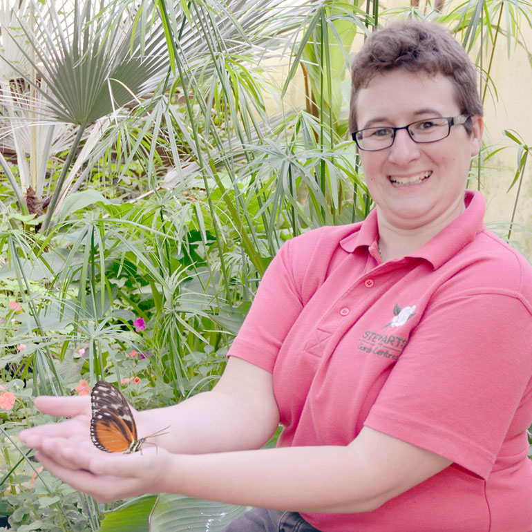 Kat Hunt with one of the tropical butterfly species at Stewarts Garden Centre