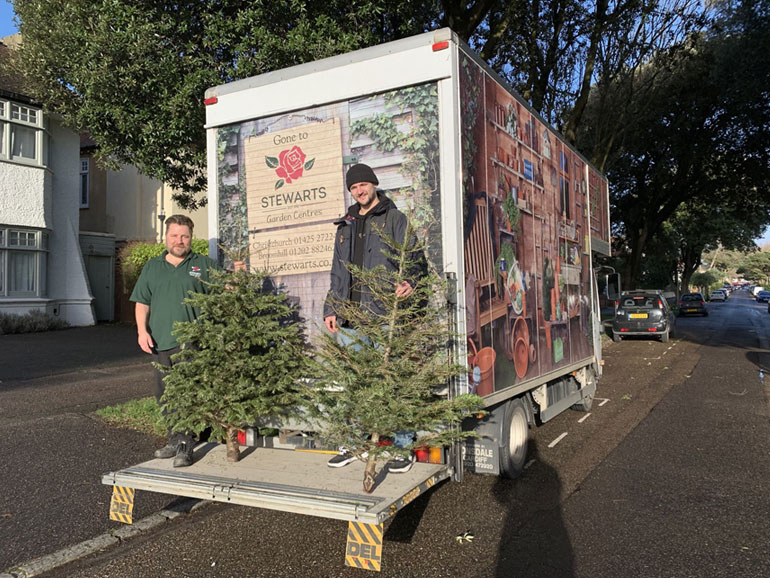 Volunteers from Stewarts collecting Christmas trees to help raise funds for Diverse Abilities