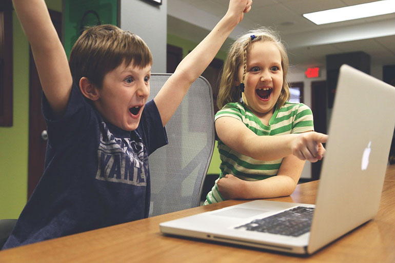 Children delighted with their laptop