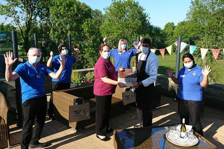 Presenting the International Nurses' Day cake at Fernhill in Longham