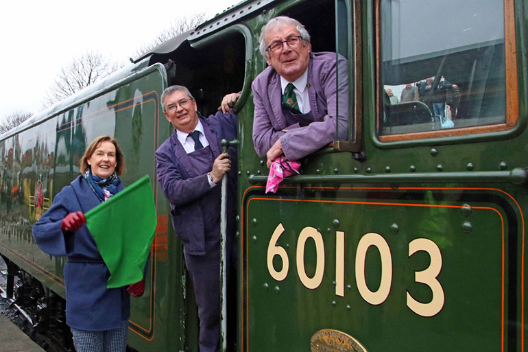 Penny Pegler waves off the first train to be hauled by Flying Scotsman in Swanage last year. Photo by Andrew Wright