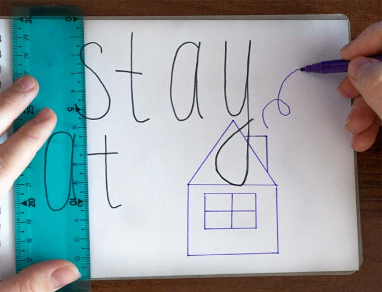 Stay at home written on whiteboard