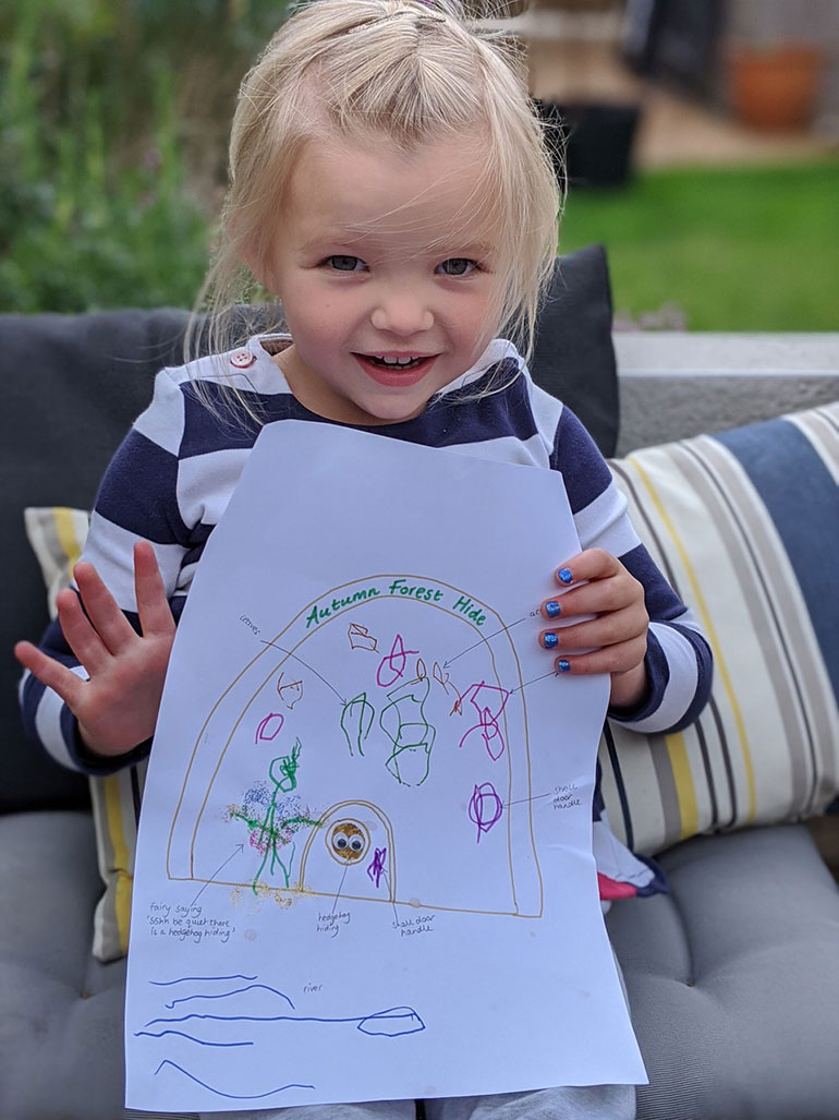 Three-year-old Autumn with her winning entry Autumn Forest Hide