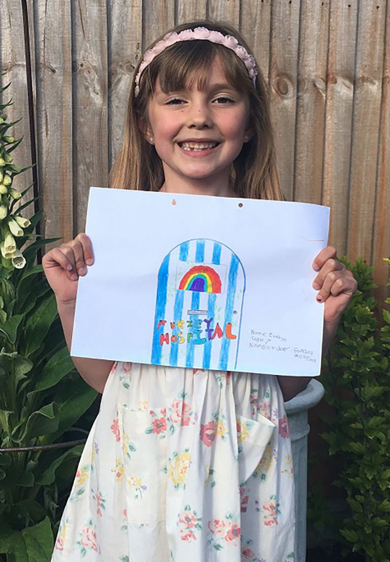 Winning design 7-11 category: Evelyn (7) with her Furzey Hospital design incorporating a rainbow